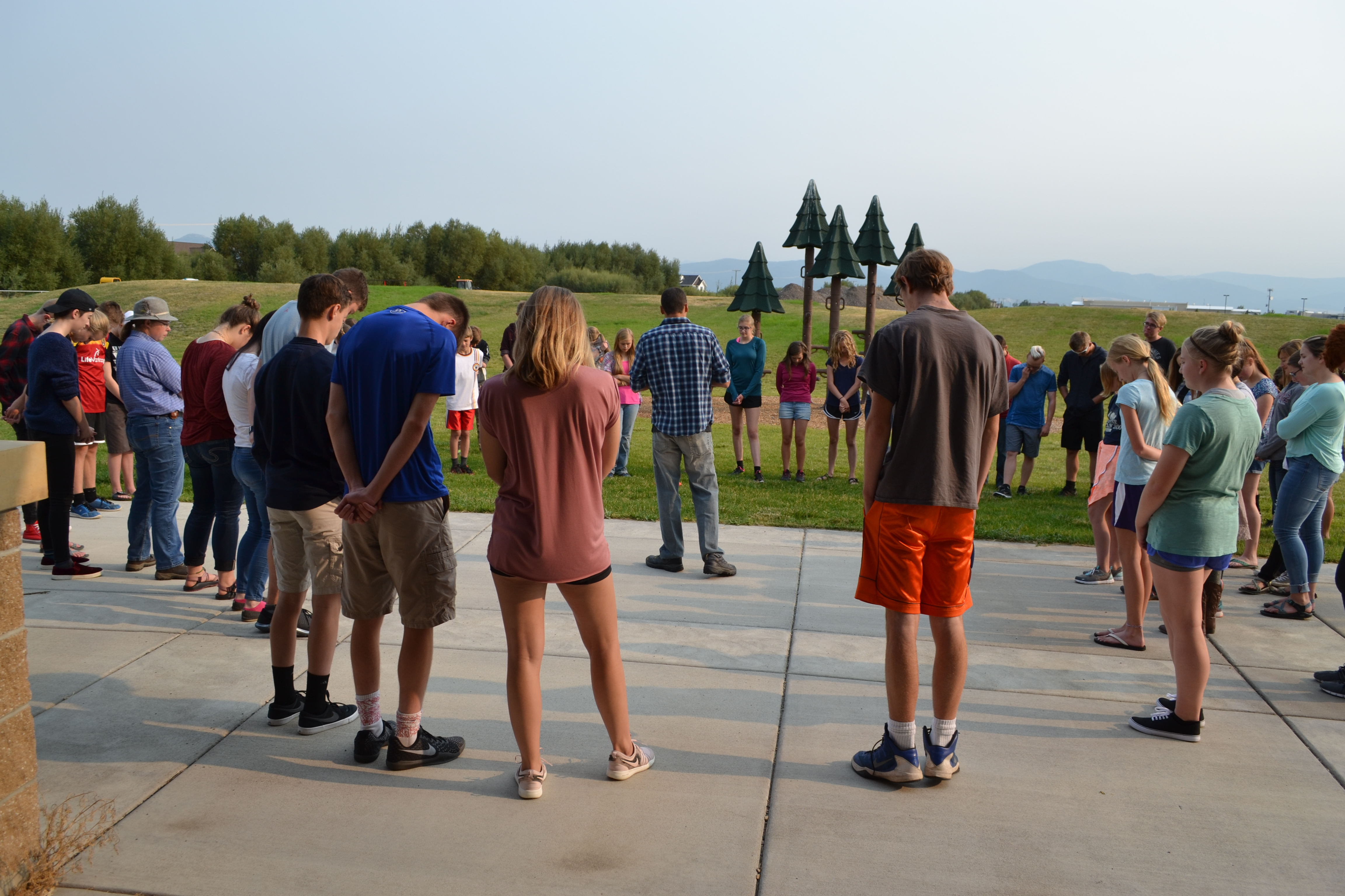 Students Praying Outside